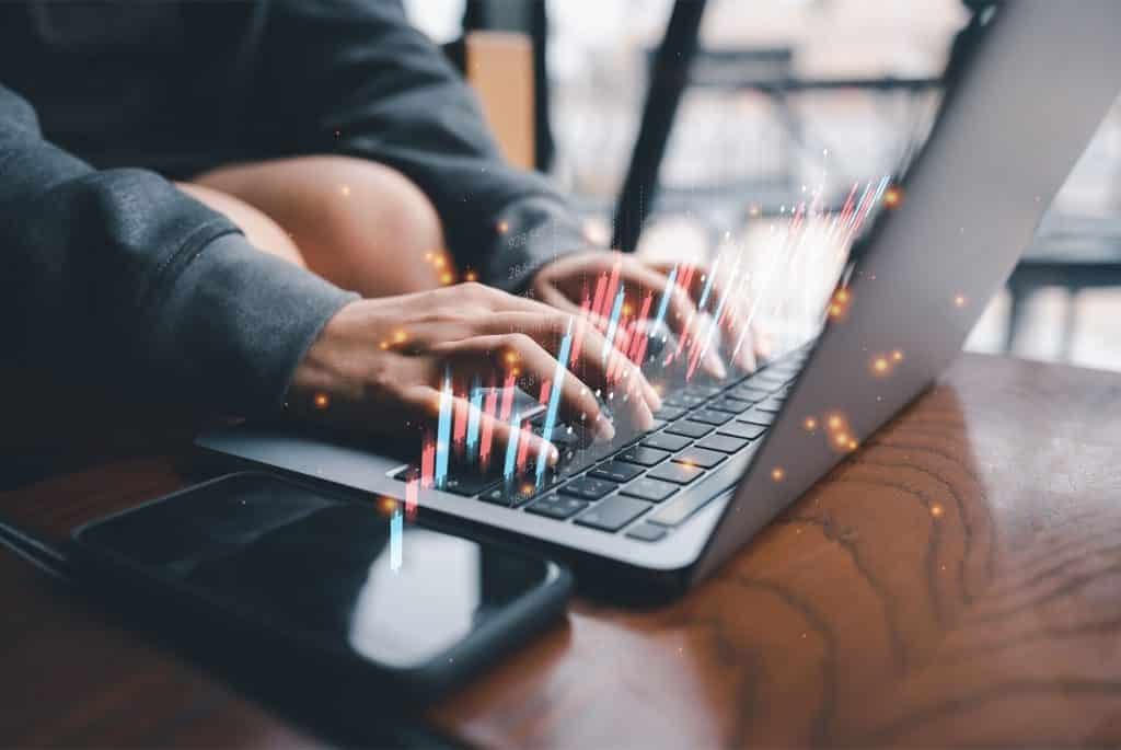 Bet forex brokers in south africa, man in front of laptop with charts 3d