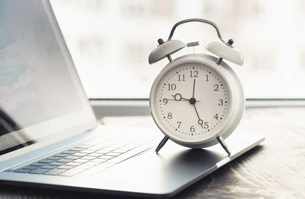how to start forex trading, Work time concept. Home office with laptop, graph and alarm clock