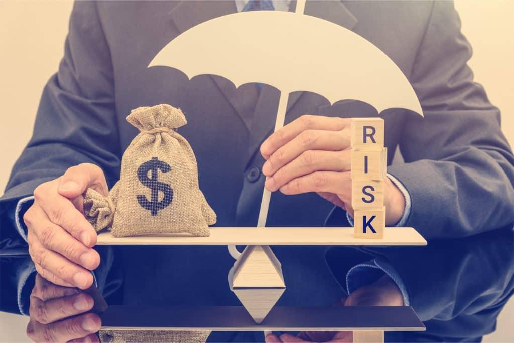 risk management forex, man holding money