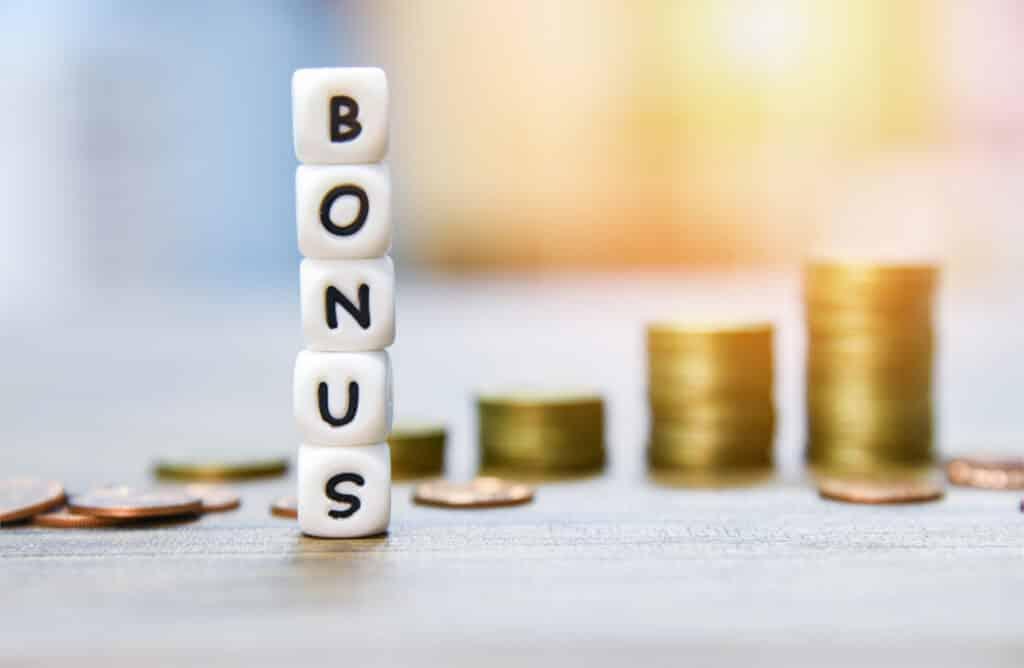 no deposit bonus written on blocks with coins in background
