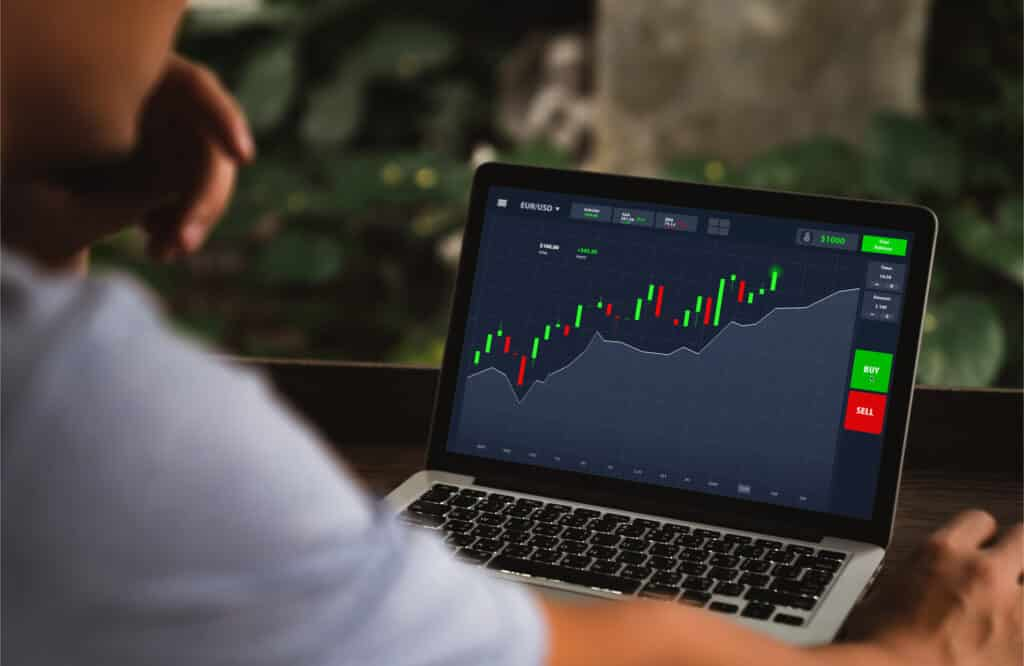 trading platforms man with tablet trading forex